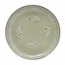 A CHINESE CELADON 'FISH' DISH circular, the centre
