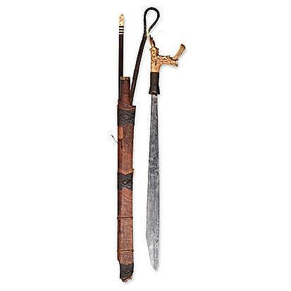 AN IBAN SWORD AND SCABBARD, BORNEO the carved bone