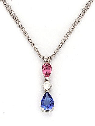 A TANZANITE, DIAMOND AND PINK TOURMALINE PENDANT claw-set with a pear-shape