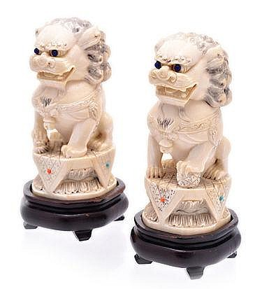 A PAIR OF CHINESE JEWELLED CARVED IVORY DOGS-OF-FO