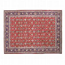 A TABRIZ CARPET, MODERN the red field with an overall design of multicolour
