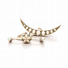 AN OPAL AND DEMANTOID GARNET BROOCH of crescent form, set with oval opals o