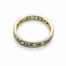 A FULL EMERALD ETERNITY RING channel-set with carré-cut emeralds weighing a