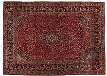A KESHAN CARPET, PERSIA, MODERN the madder-red field with an indigo-blue fl
