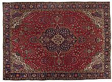 A TABRIZ CARPET, NORTH WEST PERSIA, MODERN the red field with a blue and iv