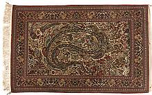 A QUM SILK RUG, PERSIA, MODERN the ivory field with large polychrome leaf d