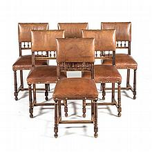 A SET OF SIX SPANISH STYLE VINYL AND FRUITWOOD SIDE CHAIRS each padded back