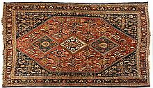 A QASHQAI RUG, SOUTH WEST PERSIA, CIRCA 1920 the madder-red field with thre