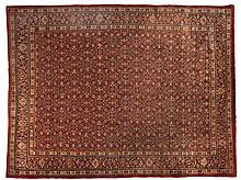 A SAROUK CARPET, PERSIA, MODERN the red field with the overall herati patte