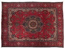 A TABRIZ CARPET, NORTH WEST PERSIA, MODERN the red field with a blue and gr
