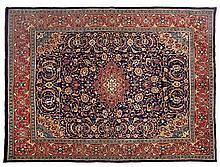 A SAROUK CARPET, WEST PERSIA, MODERN the deep indigo-blue field with a red