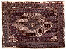 A MOOD CARPET, PERSIA, MODERN the blue field with an ivory and blue medalli