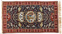 A QUM RUG, PERSIA, MODERN the indigo field with an ivory pictorial medallio