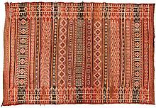 AN AFGHAN FLATWEAVE RUG, CIRCA 1930 the madder field with multi-coloured de
