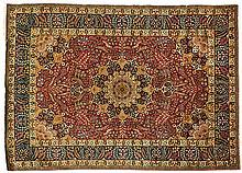 A TABRIZ RUG, PERSIA, CIRCA 1950 the red field with a blue and gold floral