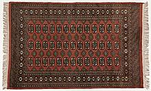 A PAKISTANI RUG, MODERN the rose field with three rows of guls and side gul