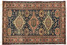 A CAUCASIAN RUG, MODERN the blue field with three medallions in rose and iv
