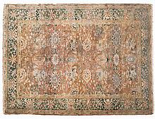 AN INDO-PERSIAN CARPET, MODERN the pale-rose field with an overall design o