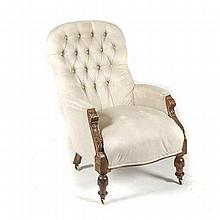 A VICTORIAN MAHOGANY AND UPHOLSTERED ARMCHAIR the padded button-back above