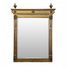 AN ENGLISH GILTWOOD MIRROR the rectangular bevelled plate within a fluted a