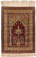 A HEREKE SILK PRAYER RUG, TURKEY, MODERN the madder mehrab with hanging lam