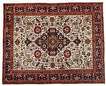 A TABRIZ CARPET, NORTH WEST PERSIA, MODERN the ivory field with a geometric