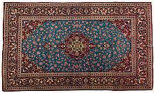 A KESHAN PART SILK RUG, PERSIA, MODERN the sky-blue field with a floral red
