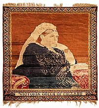 A TURKISH SILK RUG, CIRCA 1900 the madder-red field with an image of Queen