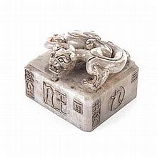 A CHINESE HARDSTONE SEAL the square seal carved with a coiled 'Chilong' gri