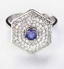 A TANZANITE AND DIAMOND RING centred with a circular mixed-cut tanzanite we