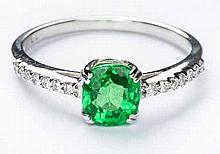 A TSAVORITE AND DIAMOND RING centred with a cushion-cut tsavorite weighing