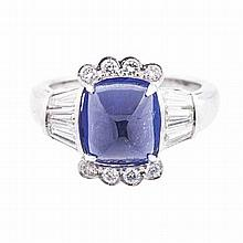 A TANZANITE AND DIAMOND RING centred with a cushion-cut tanzanite weighing