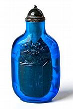 A CHINESE COBALT BLUE PEKING GLASS SNUFF BOTTLE on a short oval foot, the o