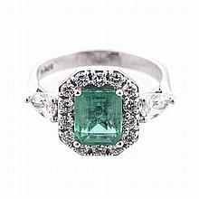 AN EMERALD AND DIAMOND RING centred with a square emerald-cut emerald weigh