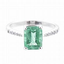 AN EMERALD AND DIAMOND RING claw-set with an emerald-cut emerald weighing a