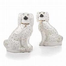 A PAIR OF STAFFORDSHIRE WHITE AND GILT SPANIELS, 19TH CENTURY of typical fo