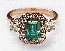 AN EMERALD AND DIAMOND RING centred with an emerald-cut emerald weighing ap