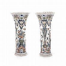 A PAIR OF DUTCH DELFT POLYCHROME VASES each of fluted trumpet form, painted