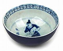 A CHINESE BLUE AND WHITE BOWL, QING DYNASTY, 19TH CENTURY rising from a sho