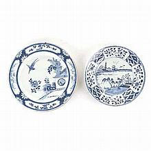 TWO CHINESE PORCELAIN BLUE AND WHITE PLATES one centred by a riverscape, pa