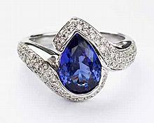 A TANZANITE AND DIAMOND RING centred with a pear-shaped tanzanite weighing