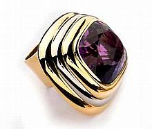 AN AMETHYST DRESS RING, KÖHLER of Art Deco design, centred with a bezel-set