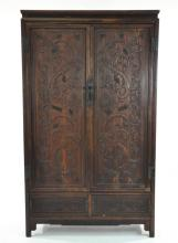 CHINESE CARVED ROSEWOOD OR HUANGHUALI CABINET