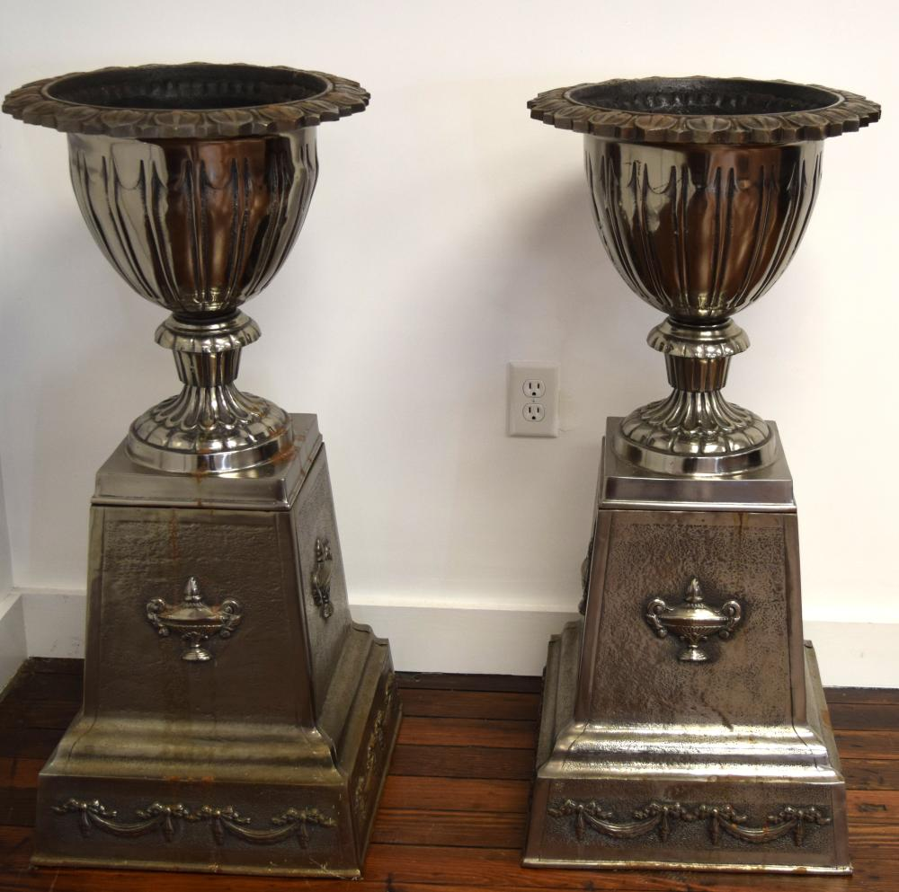 PAIR OF SILVERED CAST IRON GARDEN URNS ON STANDS: