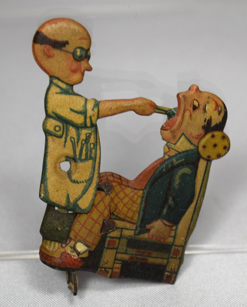 GERMAN 19TH C TIN DENTIST PENNY TOY CLICKER: