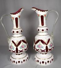 PAIR OF BOHEMIAN WHITE CUT TO CRANBERRY EWERS: