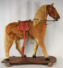 GERMAN FUR SKIN COVERD TOY HORSE ON PLATFORM