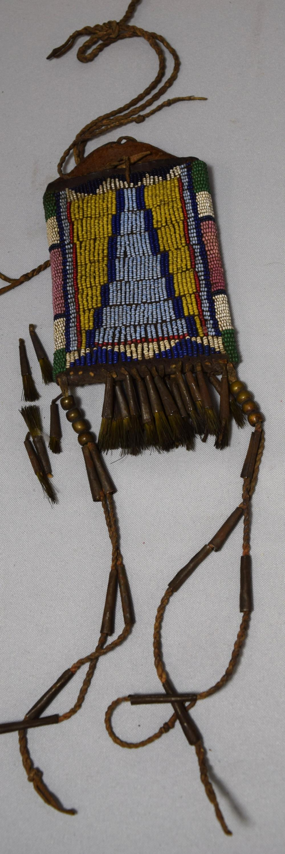 19TH C NATIVE AMERICAN INDIAN HAGING POUCH WITH HAIR TASSEL SUSPENSIONS:
