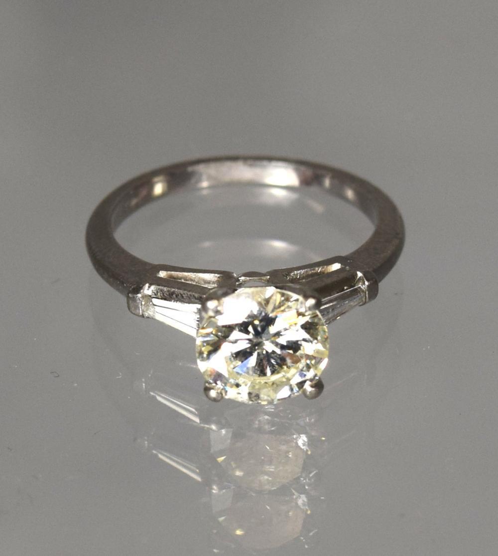 PLATINUM & ROUND DIAMOND SOLITAIRE RING: