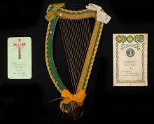 A Christmas card from Sean McGarry to Kathleen Clarke, a memorial card for Kathleen Clarke and a craftwork harp.